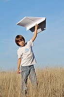 Boy and paper plane