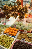 fruit and vegetables displayed in bins on the sidewalk outside a store in Chinatown, Vancouver, British Columbia, Canada