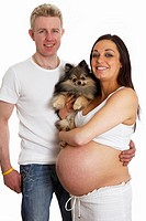 8 month pregnant 30 year old woman with 37 year old male partner and small Pomeranian pet dog