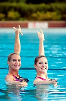 Greta Britain synchronised swimming team duet competitors, Jenna Randall 20,right and Olivia Allison 19, left  Shot at the heated pool of 1930´s Guild...