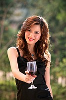 Fashionable young woman holding red wine,portrait,Fashionable young woman holding red wine,portrait,Contemporary