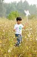 Boy running on wind farm,Boy running on wind farm,Contemporary