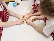 Children kneading bread