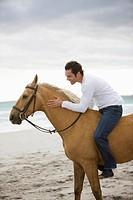 Brown horse, dark haired man, sea, beach,sand