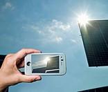 Mobile phone displaying solar panels