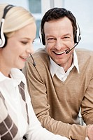 Man and woman in call center
