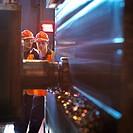 Engineer & Apprentice Using Cutting Tool