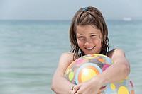 Spain, Mallorca, Girl 10_11 holding beach ball