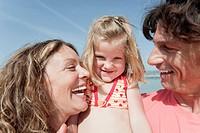 Spain, Mallorca, Family on beach, smiling, portrait