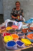 Woman selling colourful spices at market stall, Osh, Kyrgyzstan, Central Asia, Asia