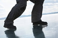 Russia.Lake Baikal, person on frozen lake, low section, close_up