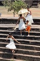 Angkor (Cambodia): bridesmaids after the wedding ceremony, at Angkor Wat
