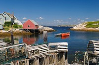 Lobster traps on the wharf in the quiet fishing village of Peggys Cove Nova Scotia