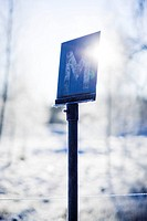 Scandinavian Peninsula, Sweden, Skåne, View of road sign sun shining behind