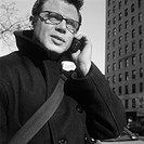 Caucasian Man Wearing A Pea Coat And Talking On His Cellphone In The City
