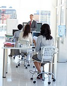 Businessman talking in front of his team in office