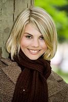 Portrait of blonde woman in autumn