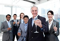 Happy diverse business group toasting with Champagne to celebrate a succes