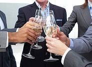 Close_up of business team toasting with Champagne in the office