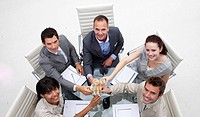 High angle of happy business team drinking champagne in the office