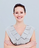 Portrait of a beautiful businesswoman with folded arms smiling at the camera
