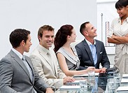 Smiling businessman in a presentation with his team