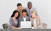 Multi_ethnic business team working with a laptop in office together