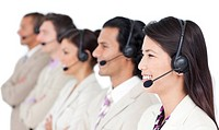 Positive business team with headset on standing in a row against a white background