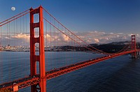 Golden Gate suspension bridge and San Francisco skyline with moon at sunset
