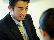 Businessman and a businesswoman discussing