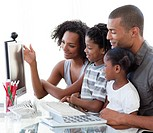 Smiling Afro_American family working with a computer at home