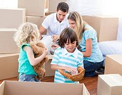 Caucasian family packing boxes while moving house