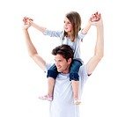 Charming father giving his daughter piggyback ride against a white background