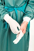 Young surgeon before an operation with gloves