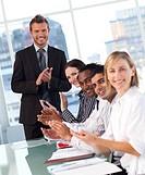 International business team applauding in a meeting