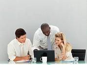 International young business people working in an office