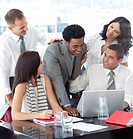Successful multi_ethnic business team working together in office