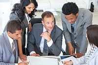 Multi_ethnic business people working together in a project in office