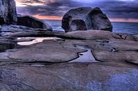 Sunset infront of a large boulder, Hono Hono, Sweden.