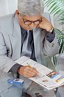 Man solving crossword , India MR551