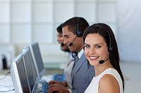Smiling beautiful businesswoman working in a call canter