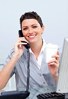 Cheerful business woman on phone and drinking coffee