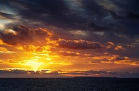 Storm clouds at sunset over Bideford Bay and Lundy Island in Devon, England