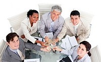 Victorious business team celebrating a success against a white background
