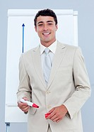 Charming businessman giving a presentation in a company
