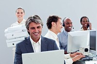 Portrait of a smiling business team at work in the office