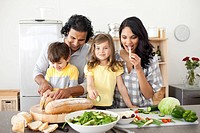 Animated family preparing lunch together in the kitchen