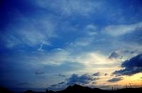 blue sky with golden sunset light evening clouds