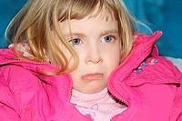 sad gesture blond little girl portrait pink coat