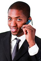 Afro_American businessman wearing an earpiece and looking at the camera